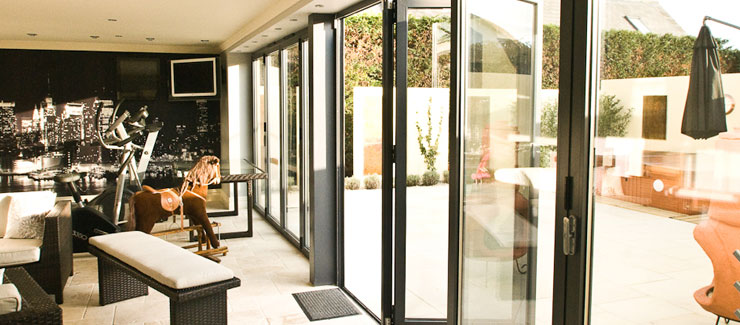 Black aluminium bifold patio door installation