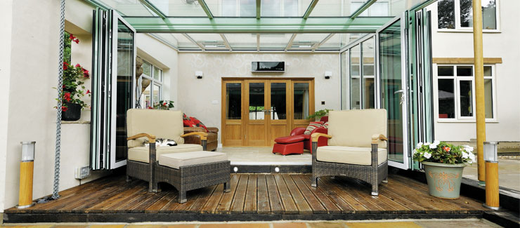 A conservatory opening onto decking area