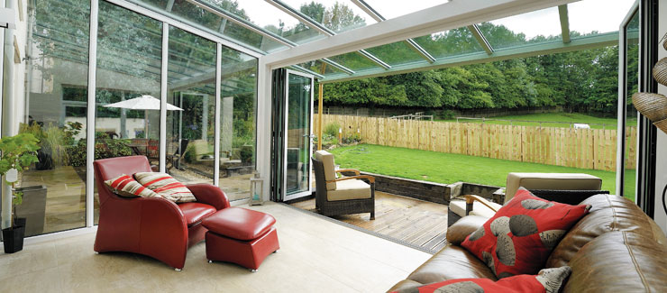 Conservatory opening onto decking and garden area