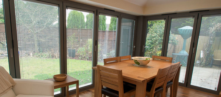 Large span of aluminium bifold doors and patio doors