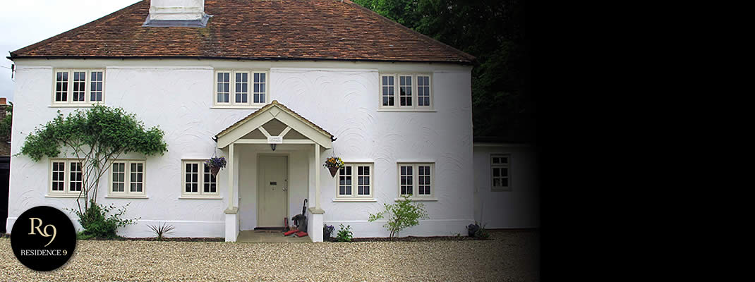 A grand white house with white Residence 9 uPVC windows
